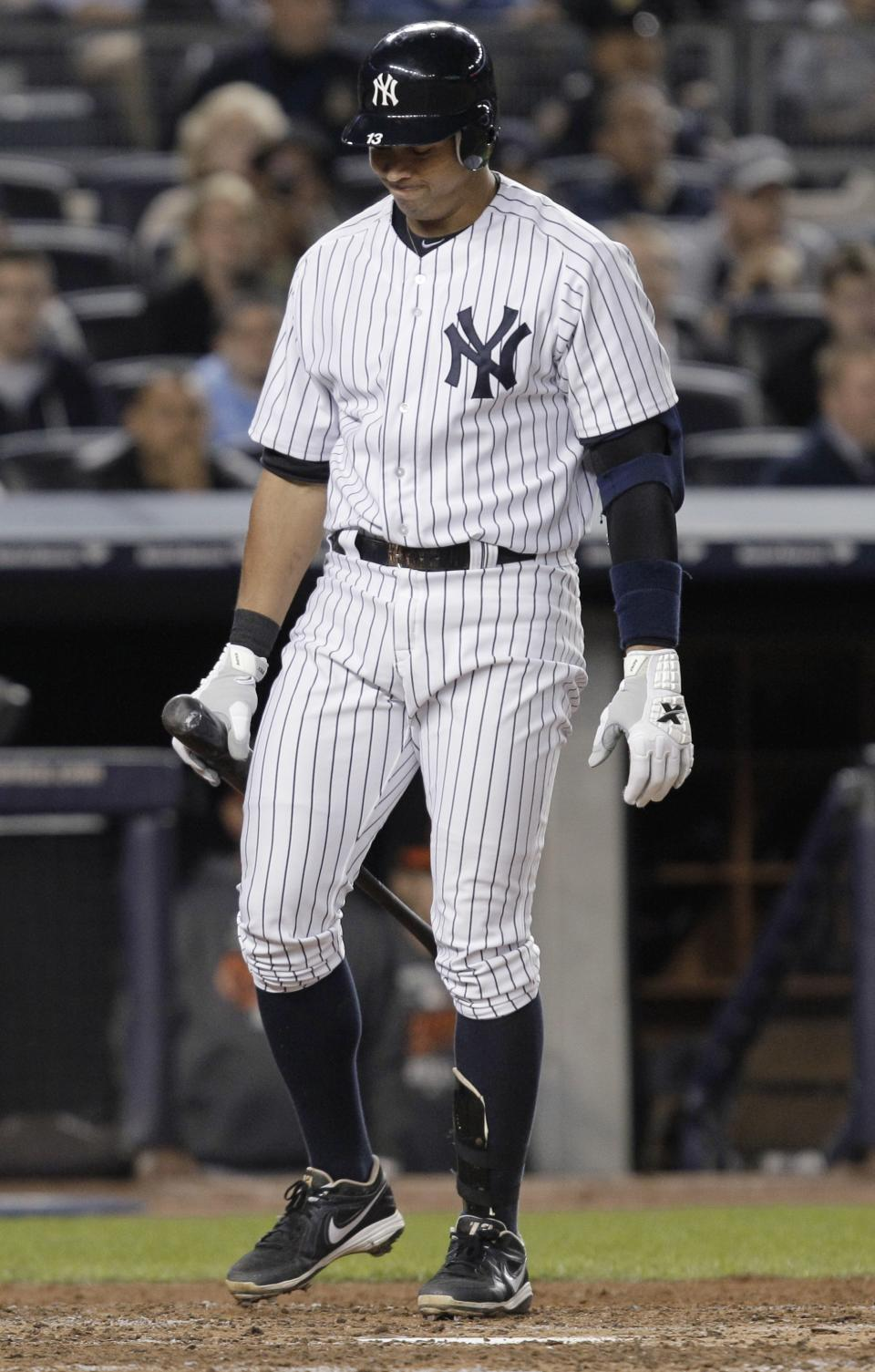 New York Yankees' Alex Rodriguez looks down after striking out during the sixth inning against the Baltimore Orioles in Game 3 of the American League division baseball series, Wednesday, Oct. 10, 2012, in New York. (AP Photo/Kathy Willens)