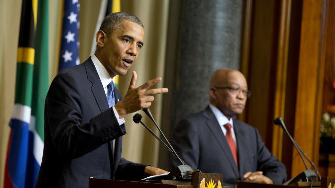 U.S. President Barack Obama, left, gestures during a news conference with South African President Jacob Zuma at the Union Building on Saturday, June 29, 2013, in Pretoria, South Africa. The president is in South Africa, embarking on the second leg of his three-country African journey. The visit comes at a poignant time, with former South African president and anti-apartheid hero Nelson Mandela ailing in a Johannesburg hospital. (AP Photo/Evan Vucci)