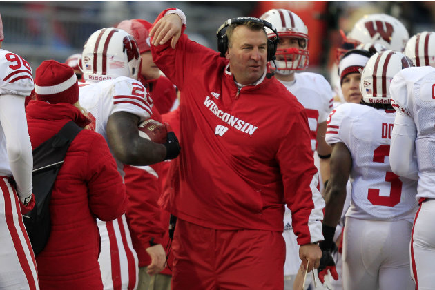 Wisconsin head coach Bret Bielema, center, celebrates with Wisconsin running back Montee Ball (28) after a touchdown run during the first quarter of an NCAA college football game against Penn State in