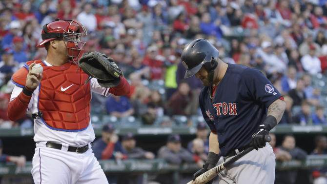 Boston Red Sox's Mike Napoli, right, heads back to the dugout after a striking out, next to Texas Rangers catcher A.J. Pierzynski during the second inning of a baseball game Friday, May 3, 2013, in Arlington, Texas. (AP Photo/LM Otero)