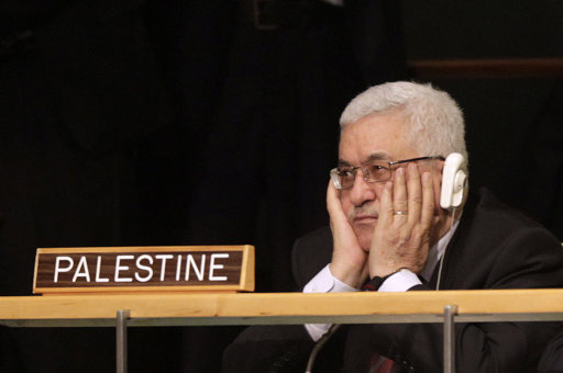 Palestinian President Mahmoud Abbas holds his hands to his face as U.S. President Barack Obama speaks during the 66th session of the General Assembly at United Nations headquarters Wednesday, Sept. 21, 2011.  (AP Photo/Seth Wenig)