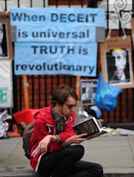<p>A man reads a book outside the Ecuadorian embassy in London, on June 22, 2012, where Wikileaks founder Julian Assange is seeking political asylum. Assange has said he chose Ecuador's embassy instead of his home country's because he felt Australia had done nothing to protect him, a charge the government has denied.</p>