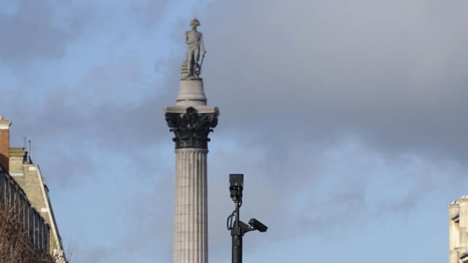 """A naked man sits on top of a statue of George, Duke of Cambridge in Whitehall, London, Friday Nov. 23, 2012.  Police and eyewitnesses say a naked man has climbed atop an equestrian statue in the heart of Whitehall, London's government district. A Scotland Yard spokesman said that the man, believed to be in his 30s or 40s, has been sitting atop the statue for the better part of two hours. He said Friday: """"We're still talking to him. We're still trying to get him down without causing any injury to him."""" (AP Photo/ Stefan Rousseau/PA) UNITED KINGDOM OUT"""