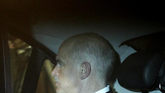 Greek Prime Minister George Papandreou travels by car as he leaves the presidential palace after a meeting with Greek President Karolos Papoulias and various other political leaders in Athens, Wednesday, Nov. 9, 2011. Greece's critical power-sharing talks have hit a significant hurdle, with political leaders leaving a top-level meeting that had been expected to conclude three days of negotiations without naming a new prime minister to take over from George Papandreou. (AP Photo/Petros Giannakouris)