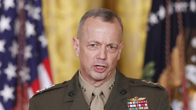 "FILE -- In an April 28, 2011, file photo then-Lt. Gen. John Allen, speaks in the East Room of the White House in Washington. U.S. defense officials say Gen. Allen, the top U.S. commander in Afghanistan, has been cleared of allegations of sending potentially inappropriate emails to a civilian woman linked to the sex scandal that ousted David Petraeus as CIA director. The officials said Tuesday, Jan. 22, 2012, the Defense Department's inspector general found the concerns about the Allen emails to be ""unsubstantiated."" (AP Photo/Charles Dharapak/file)"