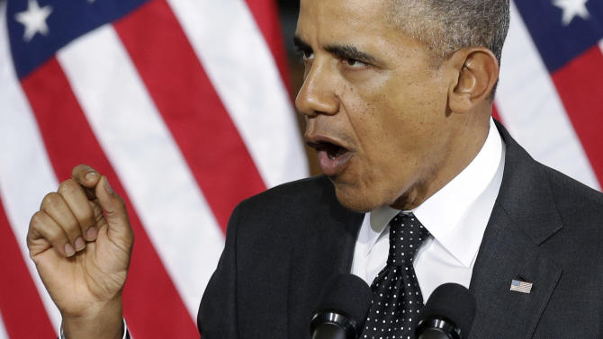 """President Barack Obama speaks at the Union Depot in St. Paul, Minn., Wednesday, Feb. 26, 2104, where he announced a new competition encouraging investments for job creation and infrastructure as part of his """"Year of Action."""" (AP Photo/Jim Mone)"""