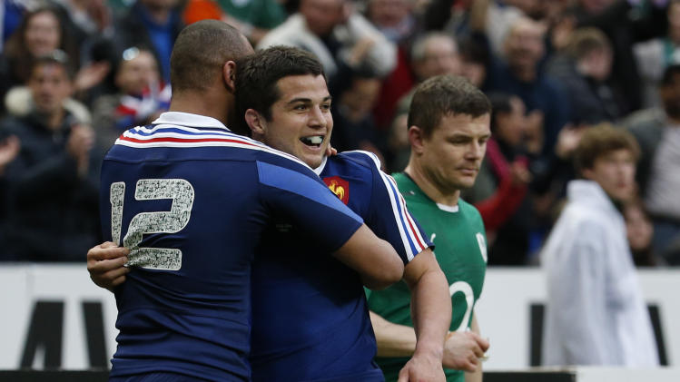 France's Dulin is congratulated by teammate France's Fickou after scoring a try against Ireland during their Six Nations rugby union match at the Stade de France in Saint-Denis, near Paris