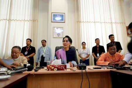 Myanmar's National League for Democracy leader Aung San Suu Kyi talks to journalists during her meeting with the media in her office at the parliament in Naypyitaw