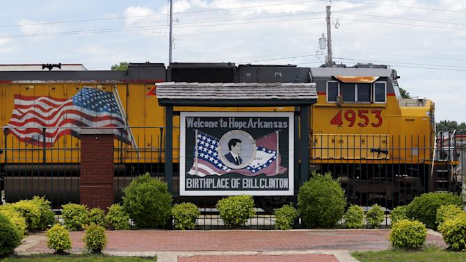 A train moves past a sign proclaiming Hope, Arkansas, as the birthplace of former U.S. President Clinton