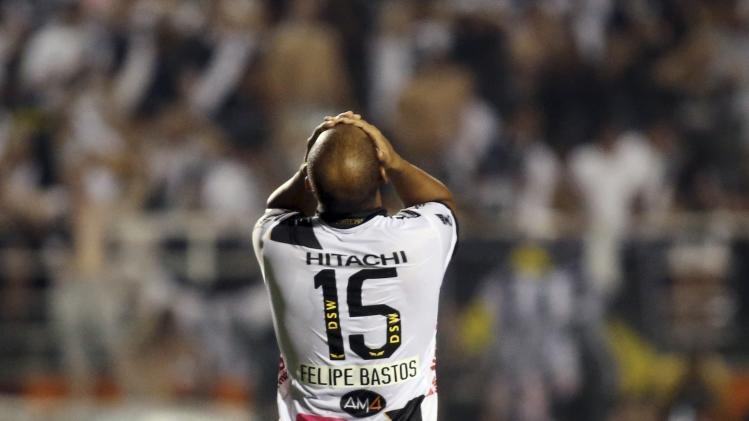 Bastos of Brazil's Ponte Preta reacts after missing a chance to score during their Copa Sudamericana first leg final soccer match against Argentina's Lanus in Sao Paulo