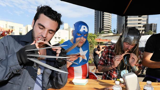 COMMERICAL IMAGE - COMMERCIAL IMAGE - A superhero panel judges a competitive rib-off at the HISTORY Cross-Country Cookout at Comic-Con on Friday, July 13, 2012 in San Diego, Calif.  (Photo by Denis Poroy/Invision for HISTORY)