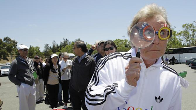 """Consumer Watchdog demonstrator Don McLeod protests in front of a Google shareholder outside of Google headquarters in Mountain View, Calif., Thursday, June 21, 2012 before the shareholders meeting. Protestors demonstrated to help raise awareness of Google's online tracking policy. They are calling for legislation for """"Do Not Track"""" mechanism urged by the FTC. They are protesting information from being gathered by Google without permission. (AP Photo/Paul Sakuma)"""