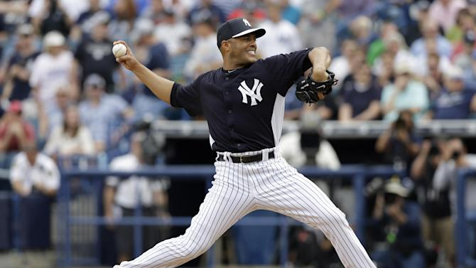 New York Yankees relief pitcher Mariano Rivera delivers against the Atlanta Braves in the fourth inning of a spring training baseball game at Steinbrenner Field in Tampa, Fla., Saturday, March 9, 2013. (AP Photo/Kathy Willens)