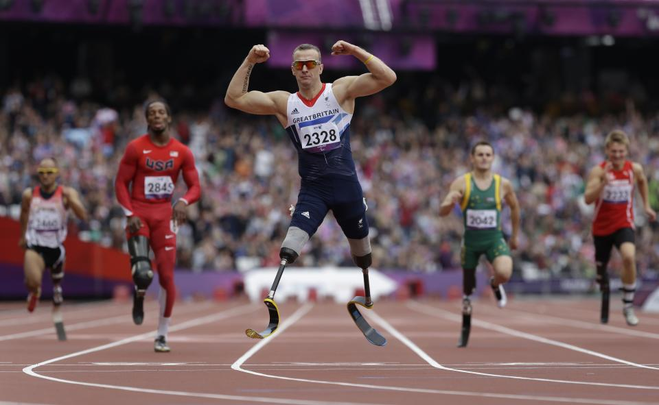 Britain's Richard Whitehead celebrates after winning the men's 200m T42 final race at the 2012 Paralympics in London, Saturday, Sept. 1, 2012. (AP Photo/Lefteris Pitarakis)