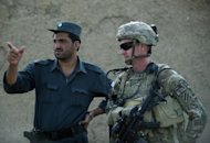 "<p>A US soldier consults with a member of the Afghan National Police during a joint patrol in Kandahar province, September 12, 2012. NATO-led forces are scaling back joint operations with Afghan forces after a spate of ""insider attacks"" in which Afghan recruits turned their weapons on Western allies, officers said.</p>"