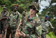 U.S. Army special forces Captain Gregory, 29, from Texas, center, who would only give his first name in accordance with special forces security guidelines, speaks with troops from the Central African Republic and Uganda, in Obo, Central African Republic, Sunday, April 29, 2012, where they are searching for infamous warlord Joseph Kony. Obo was the first place in the Central African Republic that Joseph Kony's Lord's Resistance Army (LRA) attacked in 2008 and today it's one of four forward operating locations where U.S. special forces have paired up with local troops and Ugandan soldiers to seek out Kony and hope he will stand trial at the International Criminal Court for war crimes and crimes against humanity after his forces cut a wide and bloody swath across several central African nations. (AP Photo/Ben Curtis)