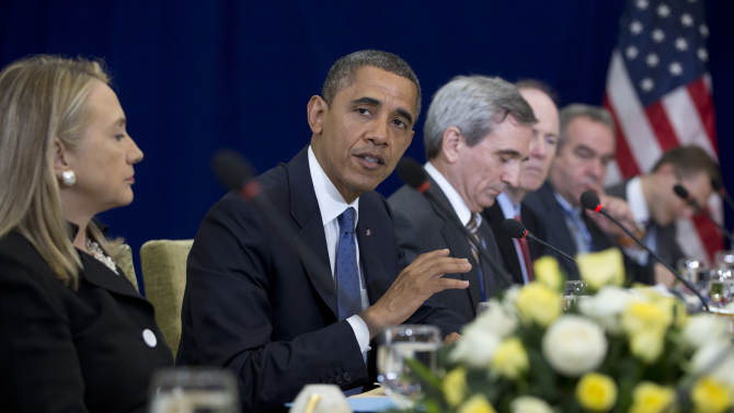 U.S. President Barack Obama, second from left, speaks as he meets with Japan's Prime Minister Yoshihiko Noda during the East Asia Summit at the Peace Palace in Phnom Penh, Cambodia, Tuesday, Nov. 20, 2012. On the left is U.S. Secretary of State Hillary Rodham Clinton.  (AP Photo/Carolyn Kaster)