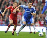 Chelsea's John Terry (R) vies with Liverpool's Jordan Henderson during their English Premier League match at Anfield, Liverpool, on May 8. Chelsea's defeat at Liverpool ended their hopes of finishing in the league top four