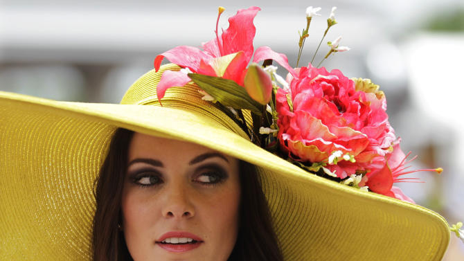 Tamara Sorrell, from Austin, Texas, wears a fancy hat in the paddocks before the 138th Kentucky Derby horse race at Churchill Downs, Saturday, May 5, 2012, in Louisville, Ky. The Run for the Roses draws them to Churchill Downs. But what race goers wear is as much a spectacle in itself. (AP Photo/Mark Humphrey)
