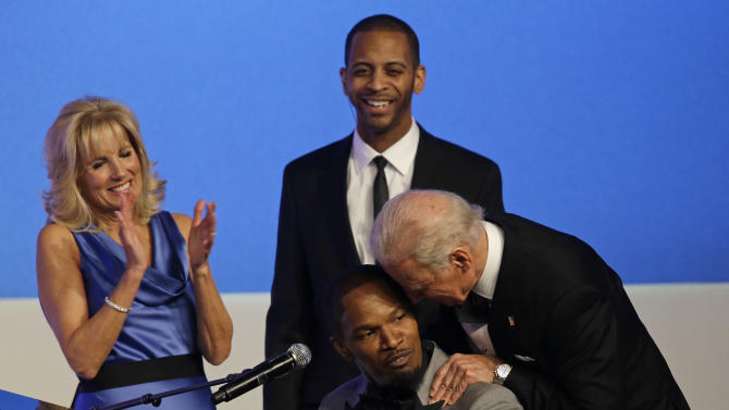 Vice President Joe Biden talks to Jamie Foxx as Jill Biden watches during The Inaugural Ball at the Washington convention center during the 57th Presidential Inauguration in Washington, Monday, Jan. 21, 2013. (AP Photo/Paul Sancya)