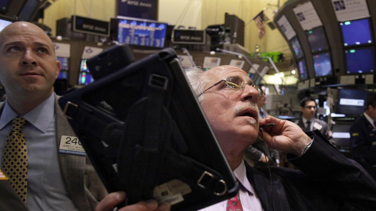 Specialist James Woods, left, and trader Peter Tuchman work on the floor of the New York Stock Exchange Monday, Sept. 19, 2011. (AP Photo/Richard Drew)