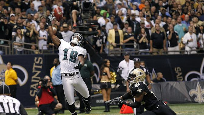 Philadelphia Eagles wide receiver Jeremy Maclin (18) can't hold onto a pass as New Orleans Saints cornerback Patrick Robinson (21) covers during the second half of an NFL football game at the Mercedes-Benz Superdome in New Orleans, Monday, Nov. 5, 2012. The Saints won 28-13. (AP Photo/Bill Haber)
