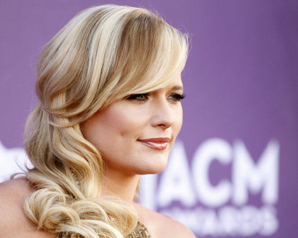 FILE - In this April 1, 2012 file photo, singer Miranda Lambert arrives at the 47th Annual Academy of Country Music Awards in Las Vegas. Lambert was nominated Monday, April 23, 2012 for four CMT Music Awards. The show will air live June 6 from Nashvhille, Tenn. (AP Photo/Isaac Brekken, file)