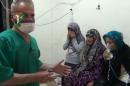 In this image taken from video obtained from the Shaam News Network, posted on April 18, 2014, an anti-Bashar Assad activist group, which has been authenticated based on its contents and other AP reporting, two women and a young girl are treated by a medic in Kfar Zeita, a rebel-held village in Hama province some 200 kilometers (125 miles) north of Damascus. Syrian opposition activists and other witnesses tell The Associated Press that Syrian government forces have attacked rebel-held areas with poisonous chlorine gas in recent months. They say the attacks left scores of men, women and children coughing, choking and gasping for breath. The reports have been denied by the Syrian government and have yet to be confirmed by any foreign country or international organization. But if true, they highlight the limitations of the global effort to rid Syria of its chemical weapons. (AP Photo/Shaam News Network)