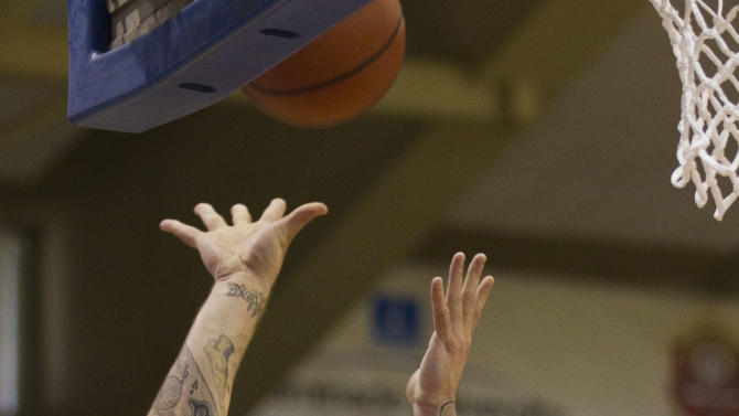 UCLA forward Reeves Nelson (22) puts up a shot over Michigan forward Jon Horford (15) in the first half of an NCAA college basketball game Wednesday, Nov. 23, 2011, in Lahaina, Hawaii. (AP Photo/Eugene Tanner)