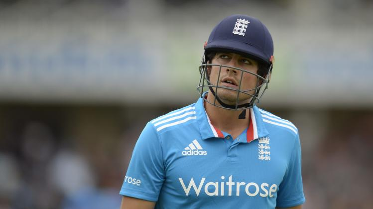 England's Cook leaves the field after being dismissed for 44 runs during the third one-day international cricket match against India at Trent Bridge cricket ground, Nottingham
