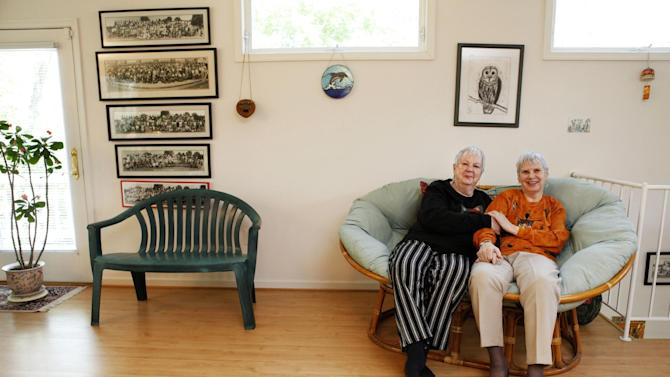 Gay rights pioneer Lilli Vincenz, 74, right, and her life partner Nancy Ruth Davis, 75, pose in their home in Arlington, Va., Thursday, May 10, 2012.  At the birthplace of the gay rights movement, patrons at New York City's Stonewall Inn said they felt like they were living history. In Wyoming, the mother of a gay man beaten to death said words couldn't express her gratitude. The president's declaration that he supports gay marriage may have lacked the urgency of Kennedy's push for the Civil Rights Act, or the force and finality of the Emancipation Proclamation, but in places key to the history of gay rights, it's being greeted as a major milestone. (AP Photo/Jacquelyn Martin)