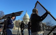 Workers put security fences in place near the Capitol building as the area is prepared for the Presidential inauguration, on January 19, 2013. Aides have offered few previews of what Obama will say on Monday, though such occasions offer the chance for presidents to stress national unity.
