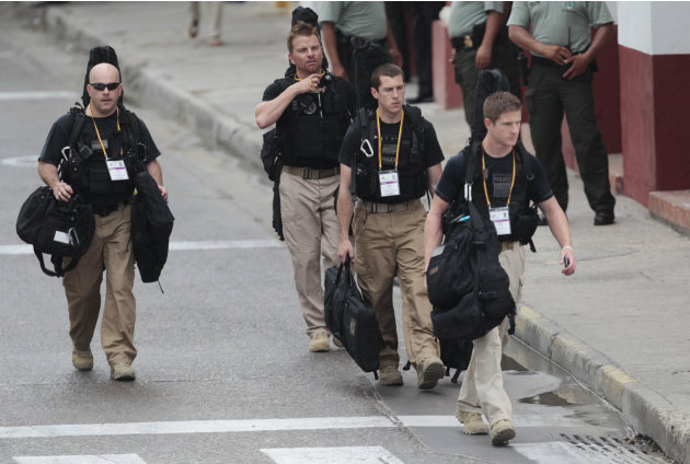 U.S. secret service agents walk around the Convention Center in Cartagena, Colombia, prior to the opening ceremony of the 6th Summit of the Americas at the Convention Center in Cartagena, Colombia, Sa