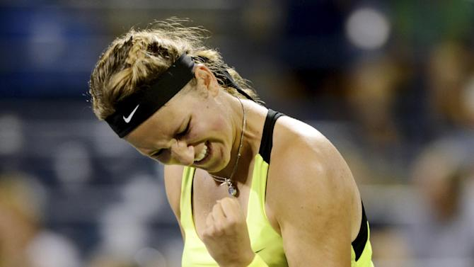 Victoria Azarenka, of Belarus, celebrates her 6-2, 6-2 win over Anna Tatishvili, of Georgia, in the fourth round of play at the U.S. Open tennis tournament, Sunday, Sept. 2, 2012, in New York. (AP Photo/Henny Ray Abrams)