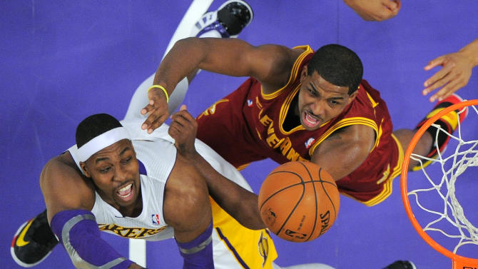 Los Angeles Lakers center Dwight Howard, left, puts up a shot as Cleveland Cavaliers forward Tristan Thompson defends during the first half of an NBA basketball game, Sunday, Jan. 13, 2013, in Los Angeles. (AP Photo/Mark J. Terrill)
