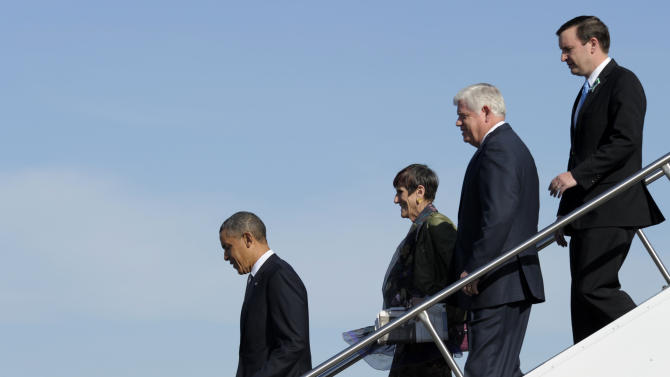 President Barack Obama,  followed by, from second from left, Rep. Rosa DeLauro, D-Conn., Rep. John Larson, D-Conn., and Sen. Chris Murphy, D-Conn., walks down the steps of Air Force One at Bradley Air Force Base, Conn., Monday, April 8, 2013. Obama traveled to the Hartford, Conn., to speak at the University of Hartford, near the state capitol where last week the governor signed into law some of the nation's strictest gun control laws with the Sandy Hook families standing behind him.  (AP Photo/Susan Walsh)