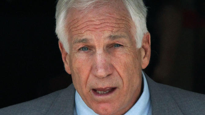 In this June 21, 2012 file photo, former Penn State University assistant football coach Jerry Sandusky leaves the Centre County Courthouse in Bellefonte, Pa. Sandusky should be sent to prison for life when a judge sentences him Tuesday, Oct. 9, 2012, according to several of the jurors who convicted the former Penn State assistant coach of molesting several boys over a period of years. (AP Photo/Gene J. Puskar)