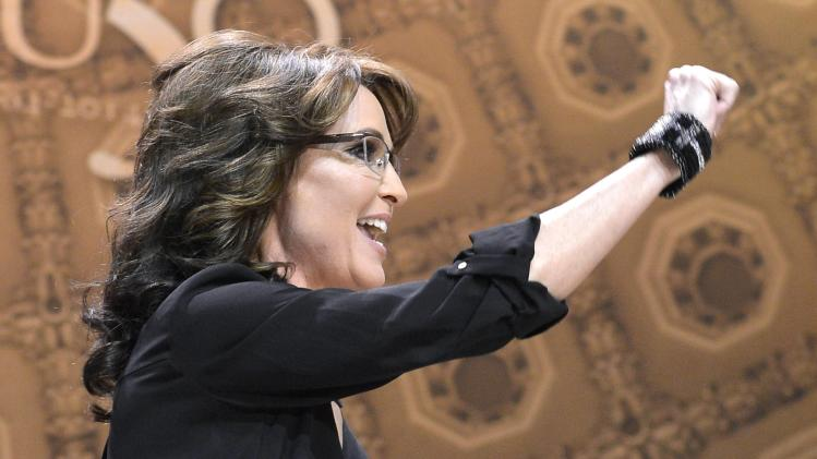 Former Alaska Governor Sarah Palin arrives onstage to address the Conservative Political Action Conference (CPAC) in Oxon Hill, Maryland