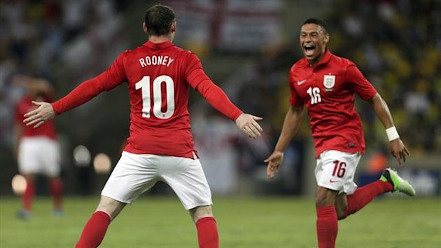 England's Wayne Rooney (10) celebrates with teammate Alex Oxlade-Chamberlain after scoring their second goal against Brazil during their international friendly match at the Maracana Stadium in Rio de Janeiro, June 2, 2013
