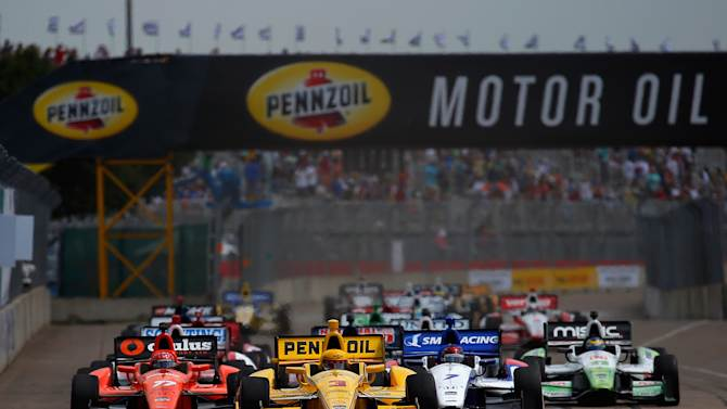 A pack of cars at the start of the Verizon IndyCar Series Shell and Pennzoil Grand Prix of Houston Race at NRG Park on June 28, 2014 in Houston, Texas