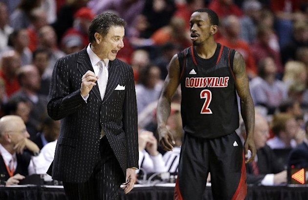 FILE - In this Dec. 22, 2012, file photo, Louisville head coach Rick Pitino talks with guard Russ Smith (2) in the second half of an NCAA college basketball game against Western Kentucky in Nashville, Tenn. The Cardinals have shown that they are comfortable being front-runners in their season-long quest to go farther than last year&#39;s Final Four appearance. Now, they enter the NCAA tournament as the overall No 1 seed. (AP Photo/Mark Humphrey, File)