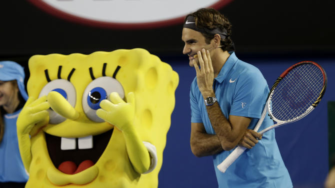 Switzerland's Roger Federer jokes with a cartoon character Sponge Bob Square Pants during an exhibition match during the Kids Tennis Day at Melbourne Park ahead of the Australian Open tennis championship in Melbourne, Australia, Saturday, Jan. 12, 2013. (AP Photo/Andy Wong)