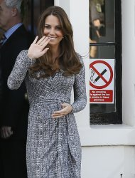 Britain's Kate, The Duchess of Cambridge waves as she leaves after a visit to Hope House, in London, Tuesday, Feb. 19, 2013. As patron of Action on Addiction, the Duchess was visiting Hope House, a safe, secure place for women to recover from substance dependence. (AP Photo/Kirsty Wigglesworth)