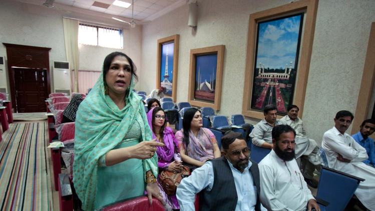 In this Wednesday, Oct. 17, 2012 photo, Almas Bobby, 42, left, the head of Pakistan's transgender community, speaks at a seminar organized by the Pakistan Election Commission to obtain suggestions for upcoming general election in Rawalpindi, Pakistan. Transgender people live in a tenuous position in conservative Pakistan, where the roles of the sexes are traditionally starkly drawn. Families often push them out of the home when they're young, forcing many to prostitute themselves to earn a living. One role where they are tolerated is as dancers at weddings and other celebrations at which men and women are strictly segregated.(AP Photo/Anjum Naveed)