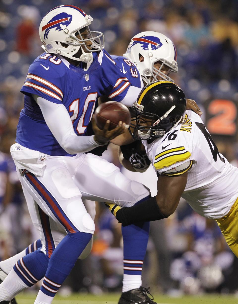 Buffalo Bills' Vince Young is pressured by Pittsburgh Steelers' Adrian Robinson (46) during the second half of a preseason NFL football game in Orchard Park, N.Y., Saturday, Aug. 25, 2012. (AP Photo/Doug Benz)