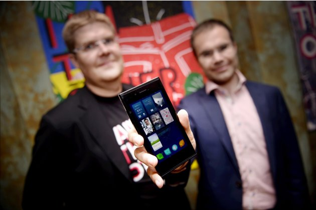 Sami Pienimaki, one of the founders of Jolla company, and Tomi Pienimaki, the company's CEO, present the new Jolla smartphone in Helsinki