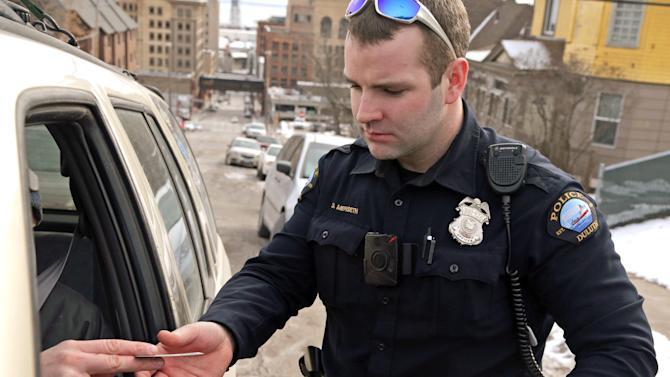 FILE - In this Feb. 2, 2015 file photo, Duluth Police Officer Dan Merseth wears a taser on his left side and a handgun on his right side during a traffic stop in Duluth, Minn. Robert Bates, the volunteer sheriff's deputy who killed an unarmed suspect in Tulsa, Oklahoma on April 2, says he accidentally fired his handgun when he meant to deploy his stun gun. Bates apologized for the shooting but described the confusion as a common problem in law enforcement. Experts agree that this is a real but very rare phenomenon that probably happens less than once a year nationwide. (AP Photo/Jim Mone, File)