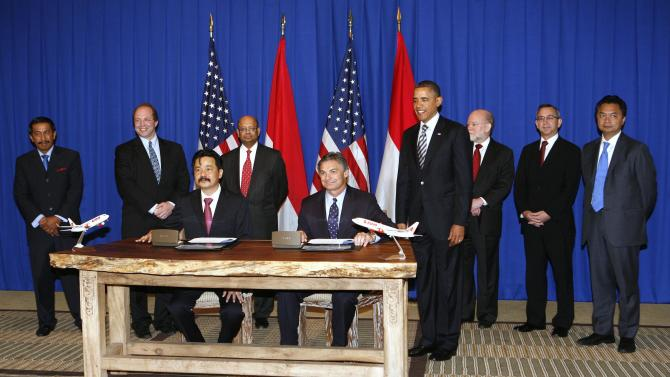 File photo of U.S. President Obama witnessing a commercial deal signed by Boeing's Conner and Lion Air CEO Kirana during a ceremony in Nusa Dua