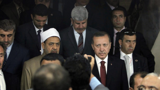 Grand Sheik of Al Azhar Ahmed el-Tayyib, center left, escorts Turkish prime minister Recep Tayyip Erdogan, center right, after their meeting at his office in Cairo, Egypt, Tuesday, Sept. 13, 2011. Erdogan, intent on broadening Turkey's influence in the Middle East and the Arab world, started a visit to Egypt and will also visit Tunisia and Libya, two other countries where popular uprisings have ousted autocratic leaders. (AP Photo/Nasser Nasser)