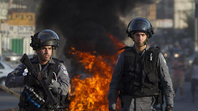 Israeli riot police keep watch during clashes that followed a protest against Israel's military offensive on the Gaza Strip, in the northern city of Nazareth, on July 21, 2014